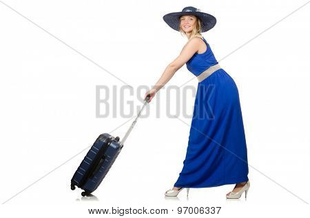 Young woman in blue dress and suitcase isolated on white