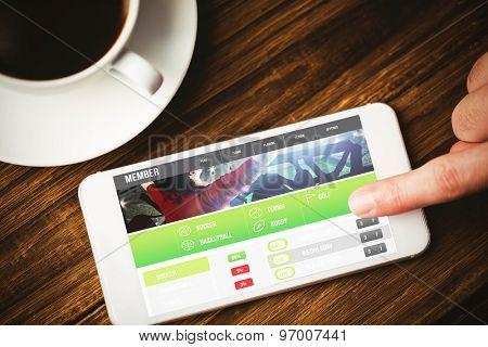 Gambling app screen against hand using smartphone