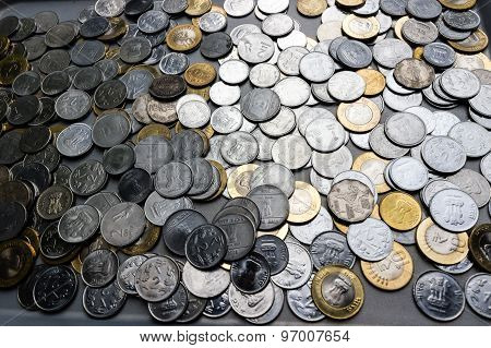 Money Investment or Savings concepts ~ Indian currency coins scattered on a plain background