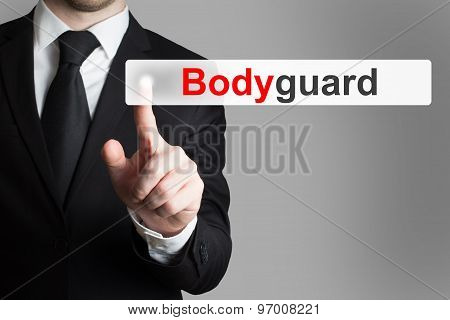 Businessman Pushing Button Bodyguard