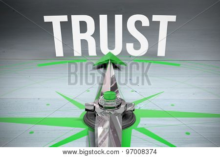 The word trust and compass against bleached wooden planks background
