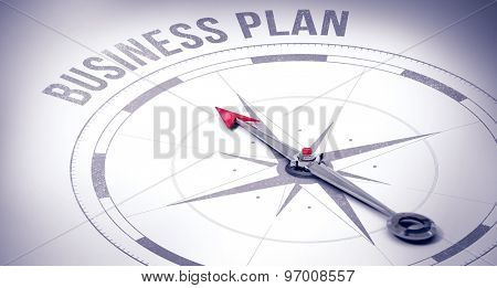 The word business plan against compass