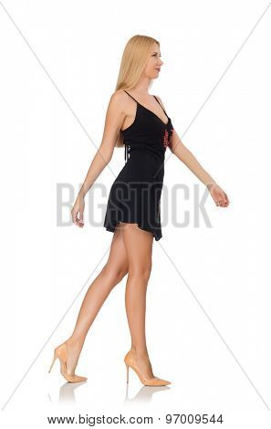 Tall young woman in black dress isolated on white