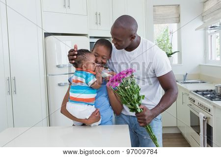 Happ couple with his babyboy in the kitchen