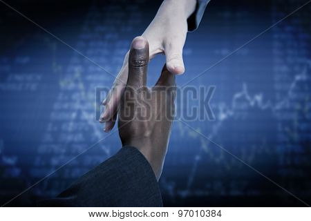 Businesspeople going to shake hands against stocks and shares