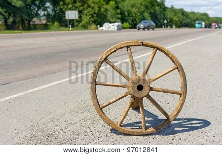 Ancient Ukrainian wheel on a roadside