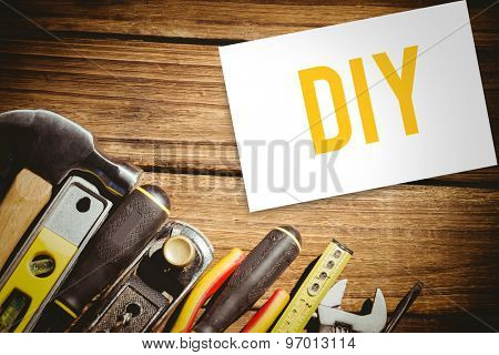 The word diy and white card against tools on desk