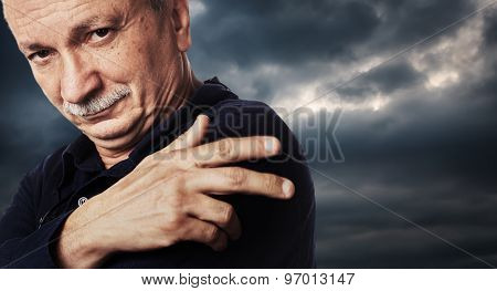Elderly Man On Cloudy Sky Background