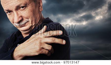 Elderly Man On Cloudy Sky Background