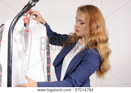 Woman In Formal Attire Chooses Shirt