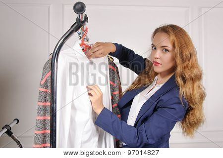 Woman In Formal Clothes Takes His Shirt Off The Rack