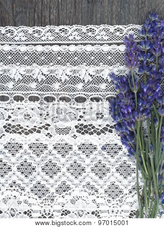 beautiful fresh lavender flowers on the lace background