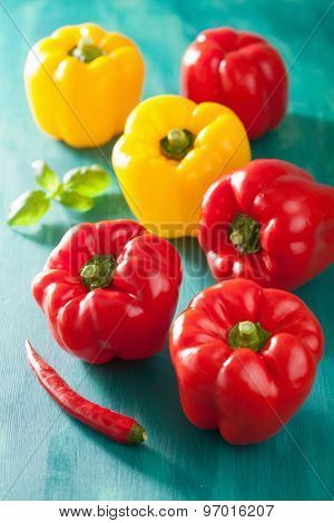 healthy vegetable red yellow peppers on turquoise background