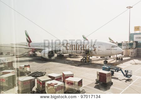 DUBAI - APRIL 10: Boeing 777 Emirats on final approach to DXB airport located in Dubai April 10 2015. Emirates is rated as a top10 best airline in the world flying on youngest fleet