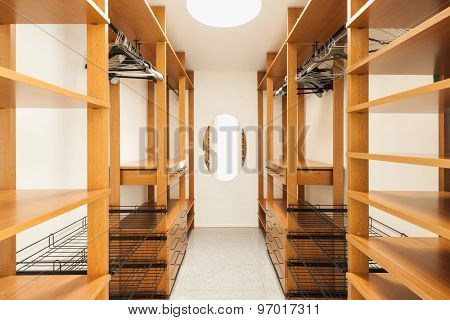 wide wooden dressing room, interior of a modern house