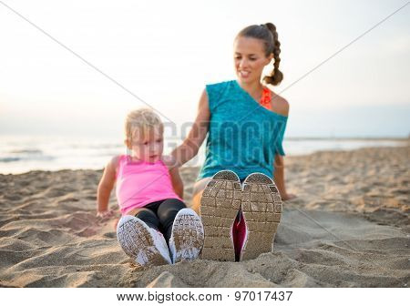 Closeup Of Mother And Child Comparing Running Shoes
