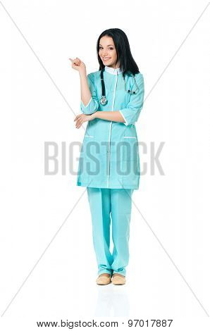 Smiling medical doctor woman with stethoscope showing something, isolated on white background