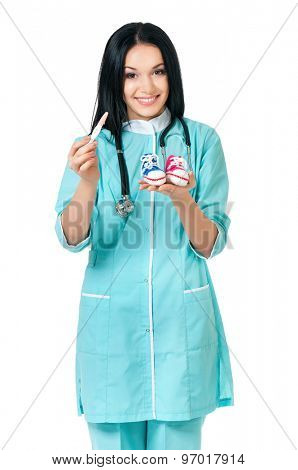 Happy young female doctor giving pregnancy test, looking at camera