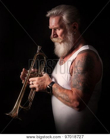 Portrait Of A Trumpet Player Looking At His Instrument