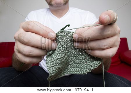 Closeup Of A Man Knitting A Scarf
