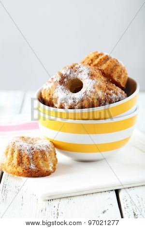 Bundt Cakes In Bowl On White Wooden Background