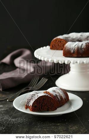 Chocolate Bundt Cake On Plate On Black Background
