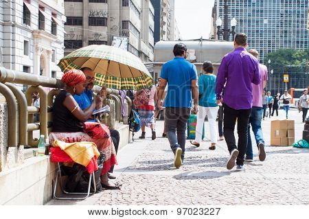 SAO PAULO,BRAZIL-APRIL 17, 2015:Unidentified fortune tellers in Santa Ifigenia viaduct on April 17, 2015 in Sao Paulo, Brazil. Santa Ifigenia is located in downtown with exclusive use for pedestrians.
