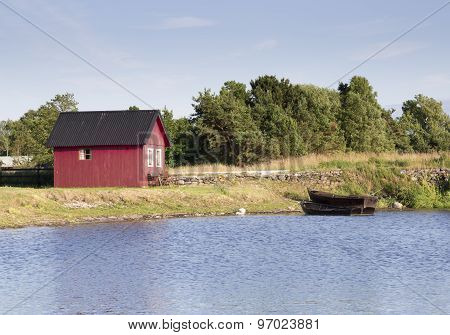 Red House By Rowing Boats