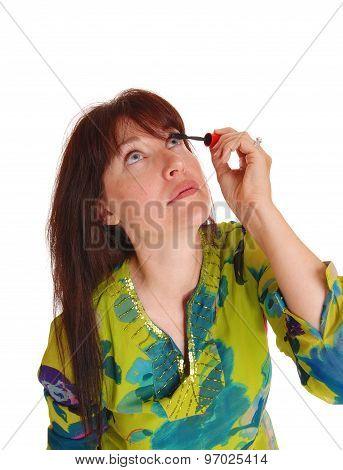 Woman Putting Makeup On Her Eyelashes.