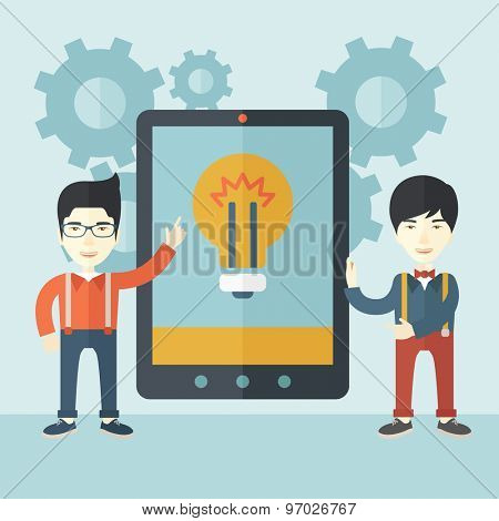 A two asian businessmen standing while holding a big screen tablet with bulb icon a computer tablet perspective view strategy marketing. Business concept. A Contemporary style with pastel palette