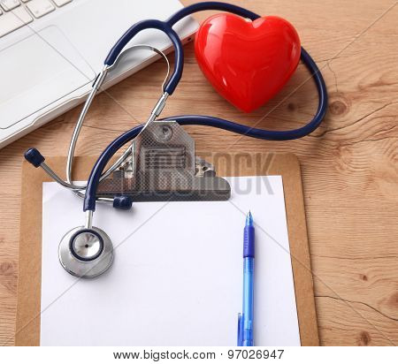 Stethoscope on laptop keyboard. Concept 3D image