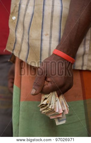 Male hand with banknotes