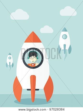 A Young asian guy inside the rocket on launch of space. Startup concept A Contemporary style with pastel palette, soft blue tinted background with desaturated cloud. Vector flat design illustration