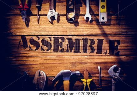 The word assemble against desk with tools