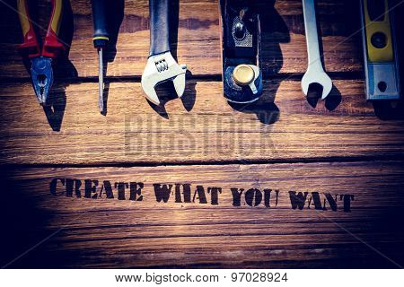 The word create what you want against desk with tools