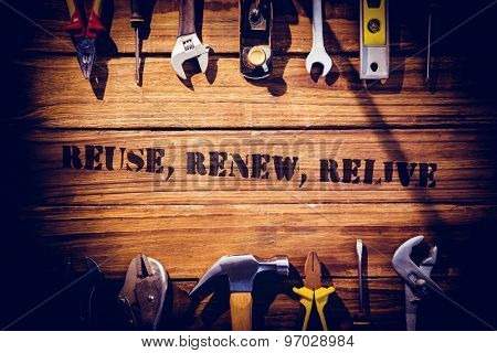 The word reuse, renew, relive against desk with tools