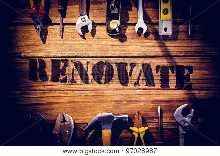 The word renovate against desk with tools