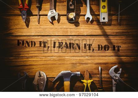 The word find it, learn it, do it against desk with tools