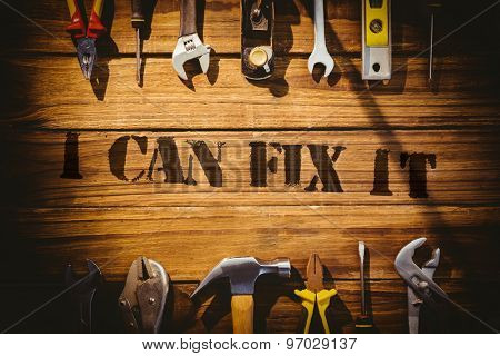 The word i can fix it against desk with tools