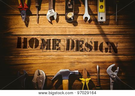 The word home design against desk with tools