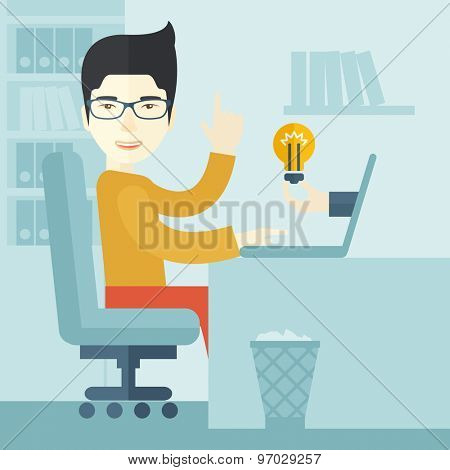 An asian businessman sitting while working infront of his desk getting a brilliant idea for business from the laptop. Business concept. A contemporary style with pastel palette soft blue tinted