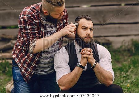 two bearded men shave