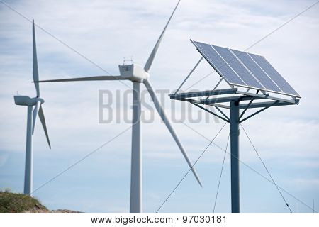 Windmill and photovoltaic panel for energy production, Zaragoza Province, Aragon, Spain.