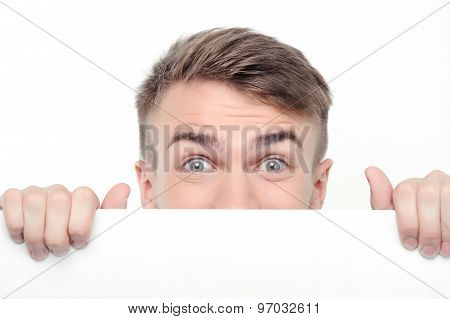 Curious man emerging from white board