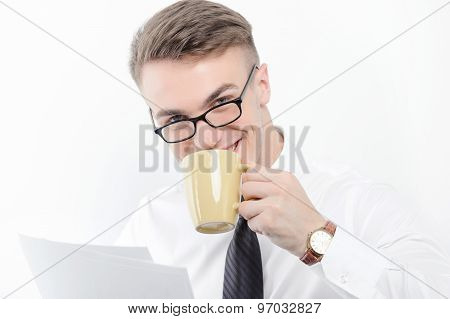 Businessman holding papers and cup of coffee