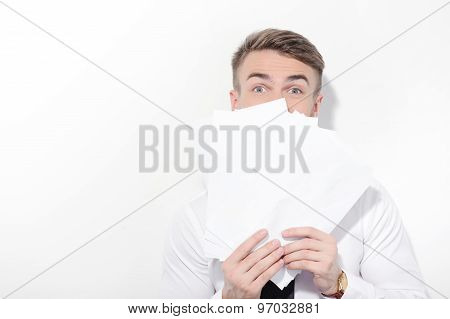 Man covering his face with some papers