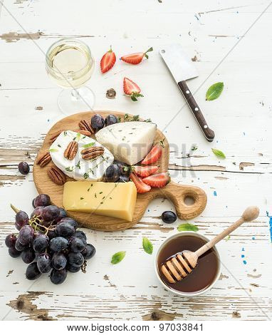 Cheese appetizer selection or wine snack set. Variety of cheese, grapes, pecan nuts, strawberry
