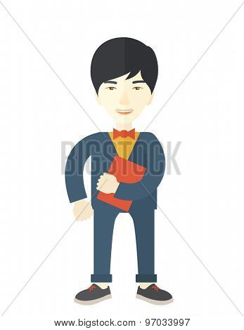 A chinese office clerk standing holding a book under his arm. A contemporary style. Vector flat design illustration with isolated white background. Vertical layout.