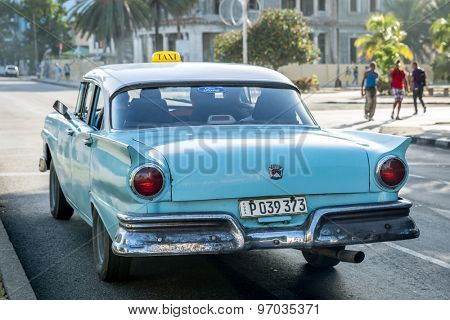 HAVANA, CUBA - CIRCA JULY 2015: Old car on Vedado district in Havana, Cuba.