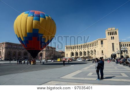 People launching colorful hot air balloon near the Government building on Republic square,Erevan